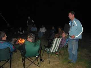 Everyone keeps warm round camp fire